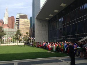 Children holding flags of the 193 United Nations member states during the peace bell ceremony taking place at the UN Headquarters.