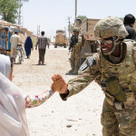 Female soldiers work with women of Afghanistan