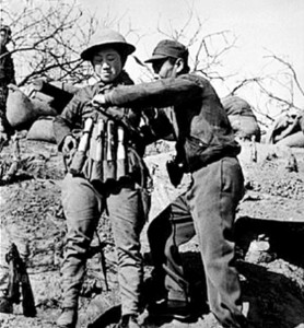 A Chinese 'dare to die' suicide bomber strapping on a 24 hand grenade vest to attack Japanese tanks during the Battle of Taierzhuang (1938). Credits: Wikipedia
