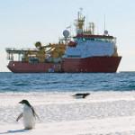 An Adelie Penguin and the HMS Protection in Cape Evans of the Ross Sea. https://flic.kr/p/CwP6Av