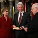 Bill Clinton looks on as Hillary Clinton is sworn in as New York State Senator by Vice-President Cheney, January 4, 2007. Photo Credit: Victor Willi (Flickr Creative Commons).