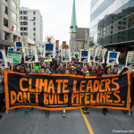 On October 24th, 99 young people were arrested in Ottawa calling on Prime Minister Trudeau to reject the Kinder Morgan tar sands pipeline. Together, they gave the Canadian Prime Minister a 'Climate 101 Crash Course' which starts with the most basic lesson -- climate leaders don't build pipelines. (Credit: Robert van Waarden | Survival Media)