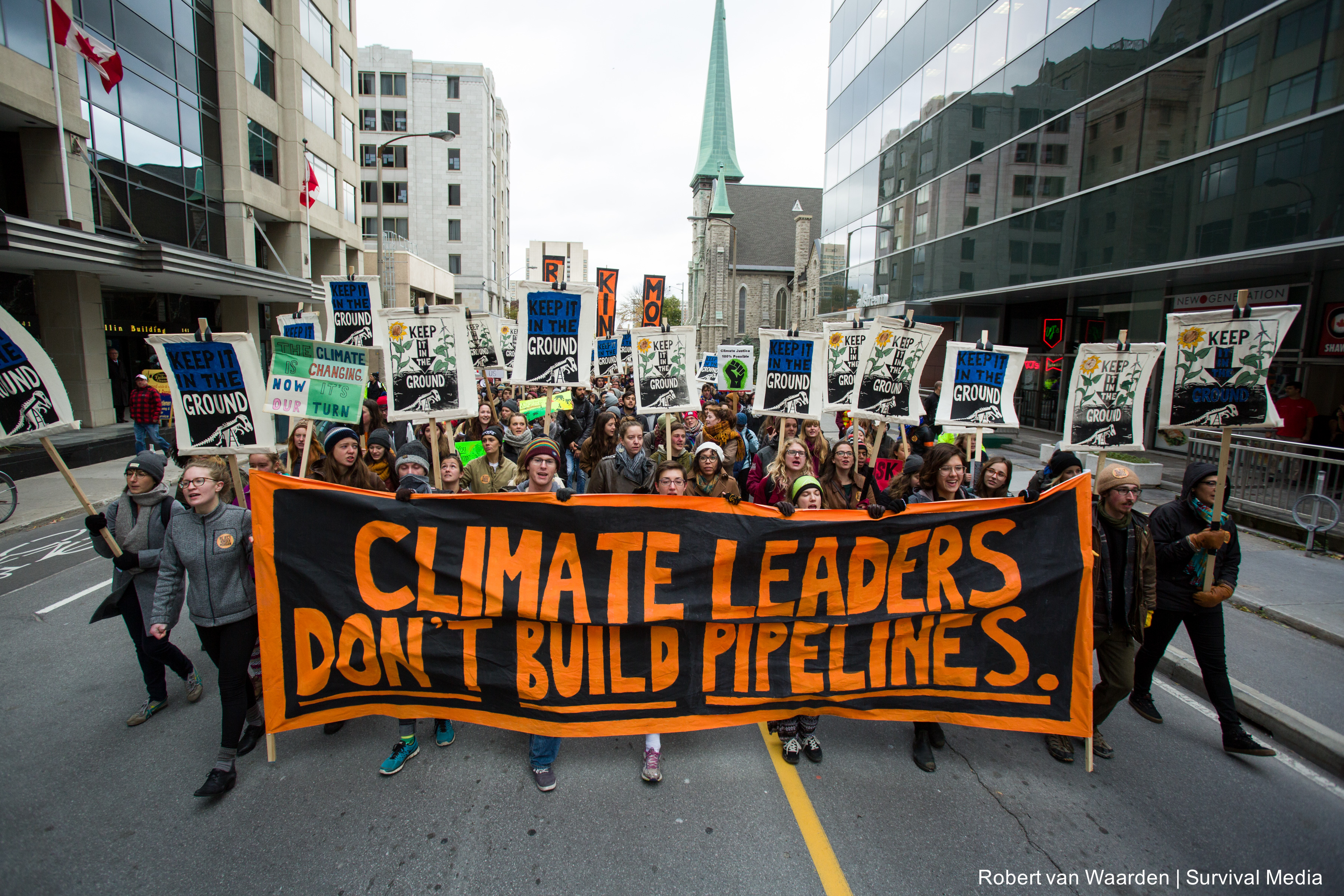 On October 24th, 99 young people were arrested in Ottawa calling on Prime Minister Trudeau to reject the Kinder Morgan tar sands pipeline. Together, they gave the Canadian Prime Minister a 'Climate 101 Crash Course' which starts with the most basic lesson -- climate leaders don't build pipelines. (Credit: Robert van Waarden   Survival Media)