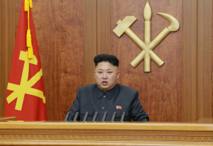 """North Korean leader Kim Jong Un delivers a speech during his New Year address in this undated photo, released by Kyodo January 1, 2014. Kim made his first reference to the execution of his powerful uncle in a New Year's address, saying the reclusive state's ruling party had become stronger after it was purged of """"factional filth."""" And as he called for better relations with South Korea, he warned that another war on the Korean peninsula would cause a massive nuclear disaster that would hit the United States. Mandatory credit REUTERS/Kyodo (NORTH KOREA - Tags: POLITICS) FOR EDITORIAL USE ONLY. NOT FOR SALE FOR MARKETING OR ADVERTISING CAMPAIGNS. THIS IMAGE HAS BEEN SUPPLIED BY A THIRD PARTY. IT IS DISTRIBUTED, EXACTLY AS RECEIVED BY REUTERS, AS A SERVICE TO CLIENTS. MANDATORY CREDIT. JAPAN OUT. NO COMMERCIAL OR EDITORIAL SALES IN JAPAN - RTX16YNU"""
